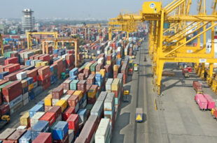 Unloading closed, pile of containers at Chittagong port